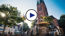 Foto der Sixtuskirche mit Play-Button